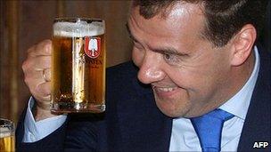 Russian President Dmitry Medvedev raises a glass with German Chancellor Angela Merkel (file image)