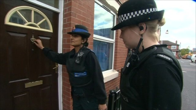 Police officers knocking on door