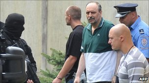 Goran Hadzic surrounded by security