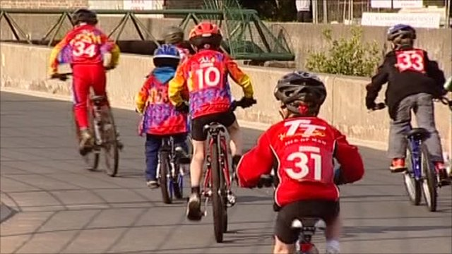 Children taking part in cycle race