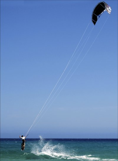 Kite-boarder in Fuerteventura [Canary Islands] in very strong winds.""