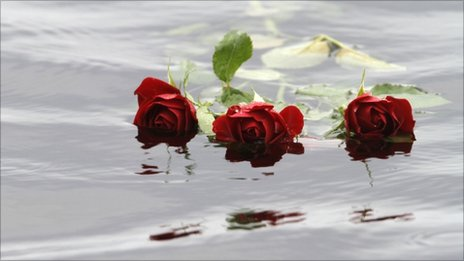 Red roses float in the water close to Utoeya island near Oslo, Norway, 26 July 2011