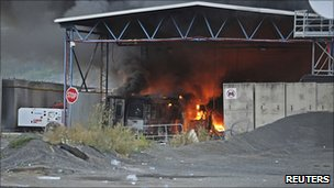 The Serbia-Kosovo border crossing in Jarinje burns after masked Serbs set it on fire on 27 July