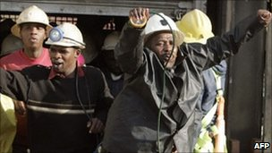 South African miners are seen as they come out from a lift after being stuck for hours in the Elandsrand gold mine, 2007