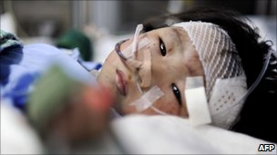 Two-year-old girl Xiang Weiyi lies in a hospital bed after she was the last survivor rescued