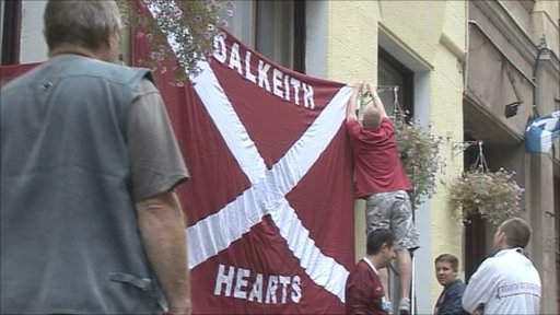 Hearts fan erect a banner in Budapest