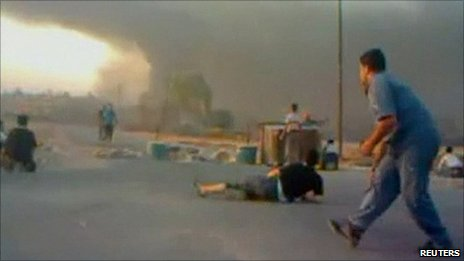 Supplied image said to show protesters in Hama avoiding gunfire. 31 July 2011