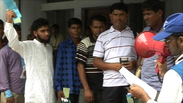 Migrant workers wait for help in Bangladesh