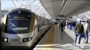 """Passengers wait to get on the Gautrain, Africa""""s first high-speed rail line, on August 2, 2011 in Pretoria."""