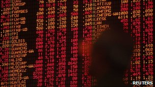 An investor monitors stock market prices in Kuala Lumpur