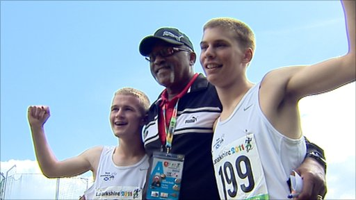 Olympic gold medalist Tommie Smith with two young athletes