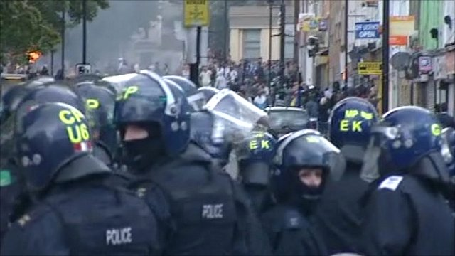 Police charge rioters in Hackney