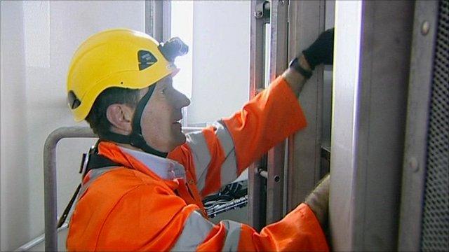 David Shukman climbing a wind turbine