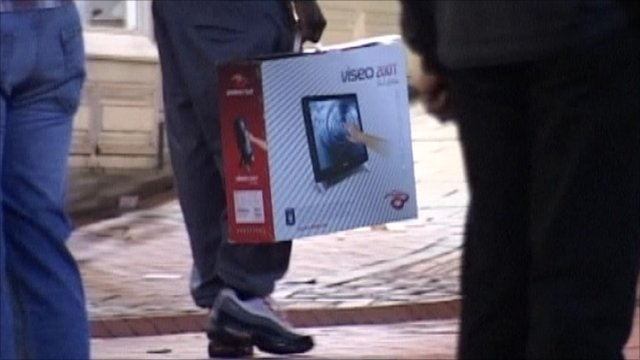 looter holds a touch screen monitor