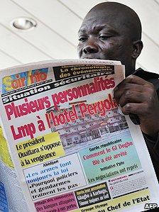 Newspaper reader in Ivory Coast