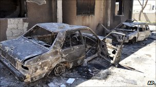 Syrian police cars are seen after a week-long military assault in Hama city