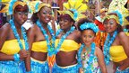 Dancers pose for a photograph before taking part in Nottingham's Caribbean carnival parade from the city centre to the Forest Recreation Ground on 14 August 2011