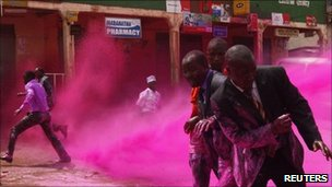 Police use coloured water to disperse opposition supporters on the outskirts of Kampala