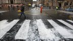 Rain washes away newly painted streets
