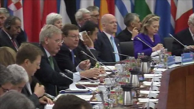 World leaders sitting around desk