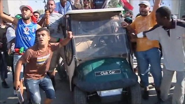 Rebels with golf buggy