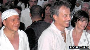 Tony Blair and wife Cherie with Italian PM Silvio Berlusconi while on holiday in 2004