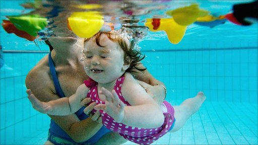 A baby swims underwater