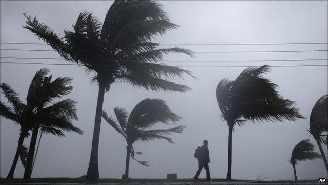 Man walking in the hurricane in the Bahamas