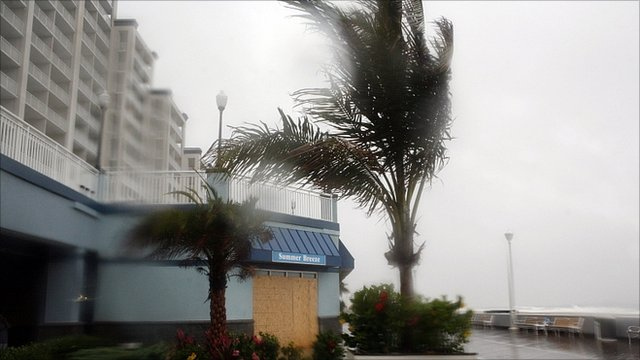 Waves lash an apartment block in Ocean City