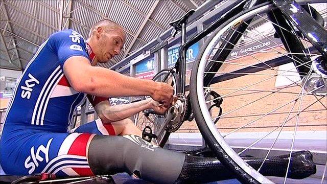 Tel Byrne adjusts his bicycle chain