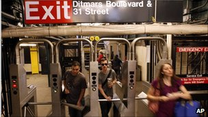 New Yorkers take to the subway as service resumes