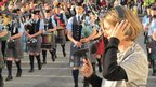 Zoe Walker records Portree Pipe Band. Pic: Walker & Bromwich
