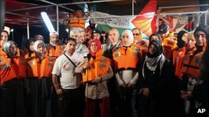Turkish activists hold a news conference on board the Mavi Marmara shortly before being boarded by Israeli commandos, 30 May 2010