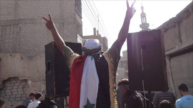 People protesting against President Bashar al-Assad