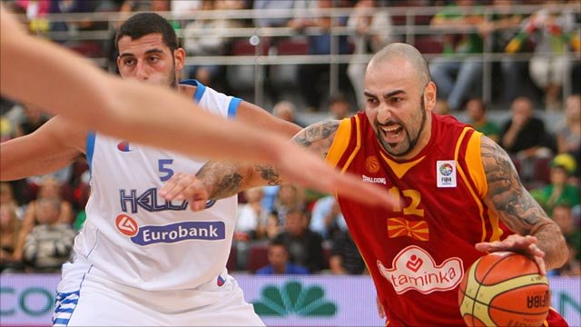 Greece's Ioanis Bourousis (left) vies with Macedonia's Pero Antic as Macedonia end Greece's 100% record
