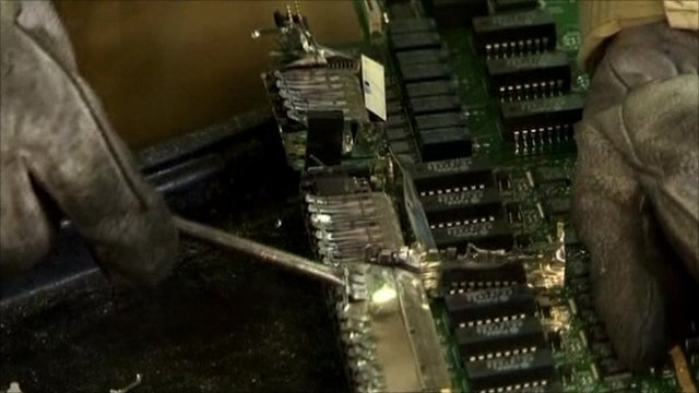 An electronic circuit board being assembled