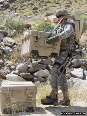 Soldier lifting weights with the HULC exoskeleton