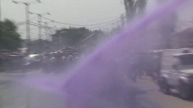 Police use water cannons to spray protesters with purple dye in Srinagar