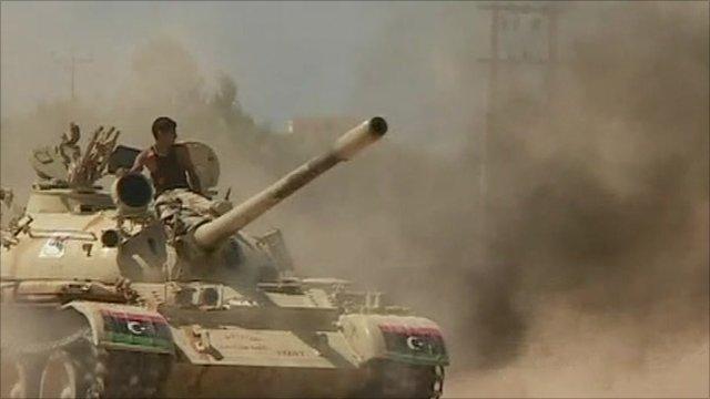 Rebels on tanks near Sirte