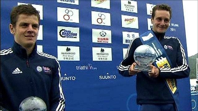Jonny and Alistair Brownlee hold their trophies