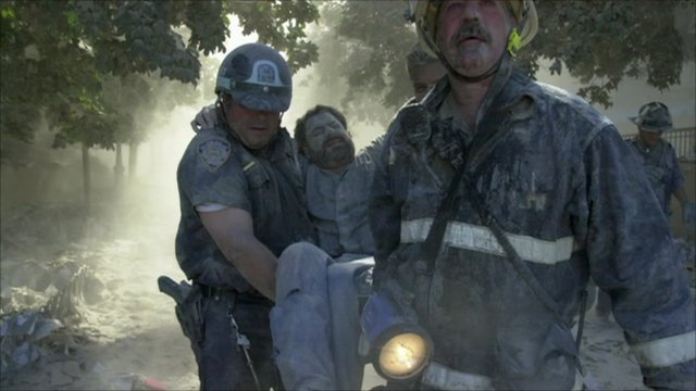 David Handschuh carried from 9/11 rubble