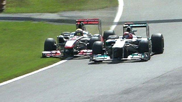 Michael Schumacher forces Lewis Hamilton on to the grass