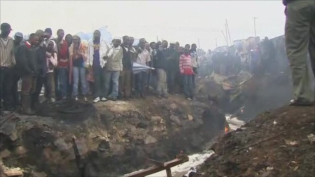 People gathered at the scene of the fire