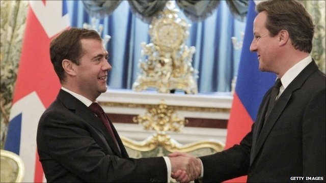 Russia's President Dmitry Medvedev (L) and British Prime Minister David Cameron (R)