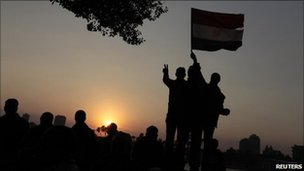 Egyptians celebrate the fall of President Mubarak after 18 days of protests