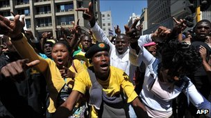 A crowd protests in Johannesburg on Monday after a court bans an anti-apartheid song