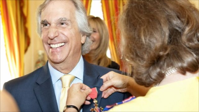 Henry Winkler with his honorary OBE