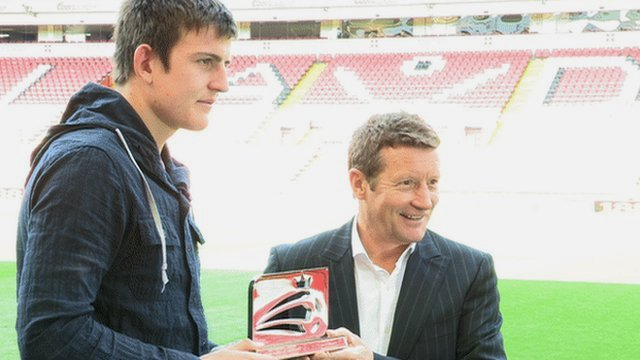 Sheffield United defender Harry Maguire is given his award by manager Danny Wilson