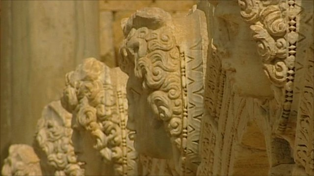 Carved stone faces