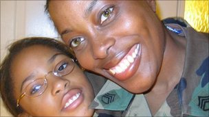 woman in military fatigues with her daughter